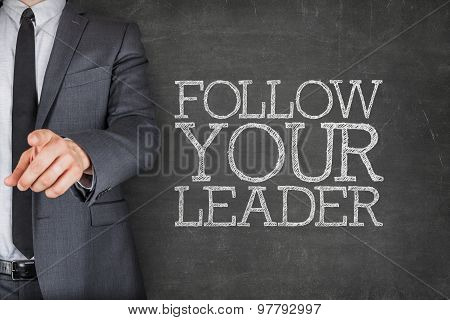 Follow your leader on blackboard with businessman