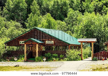 Glade Of Narzan. Wooden Building In The Forest