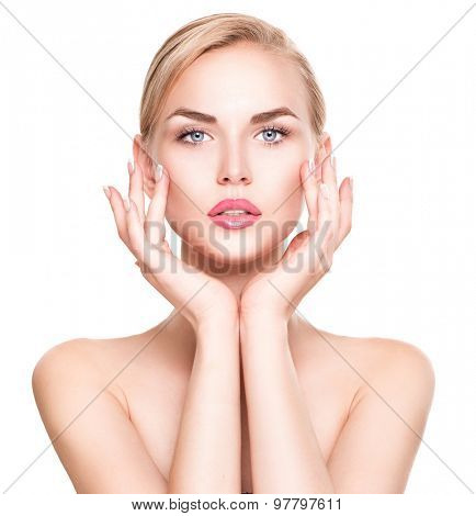 Beauty Woman Portrait. Beautiful Spa Girl Touching her Face. Perfect Fresh Skin. Pure Beauty Model Female looking at camera. Youth and Skin Care Concept. Isolated on white background