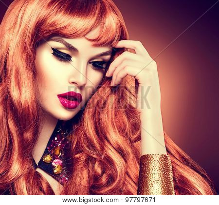 Beauty Woman Portrait. Healthy Long Curly Red Hair and perfect holiday make up. Beautiful Glamorous Girl face closeup
