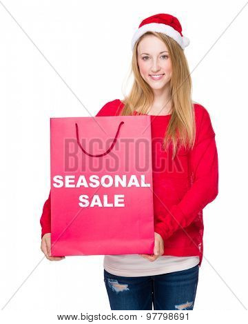 Christmas party Woman with red paper bag showing seasonal sale