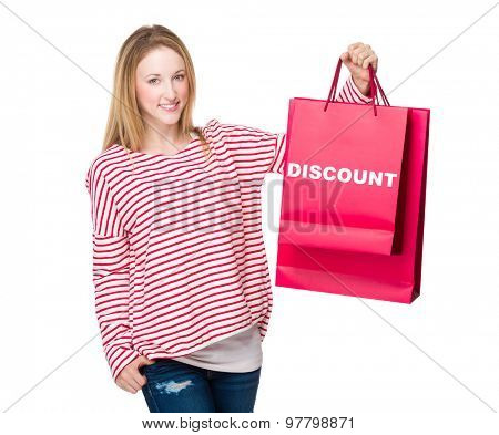 Woman holding with shopping bag and showing discount