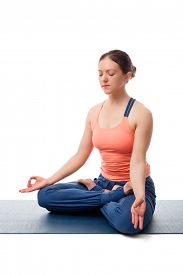 picture of mudra  - Beautiful fit yogini woman meditating  in yoga asana Padmasana  - JPG