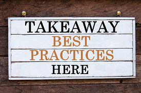 foto of takeaway  - Takeaway Best Practices Here Inspirational message written on vintage wooden board - JPG