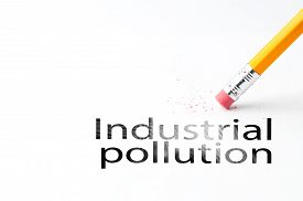 image of noise pollution  - Closeup of pencil eraser and industrial pollution text - JPG