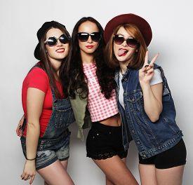 foto of three sisters  - Three stylish sexy hipster girls best friends - JPG