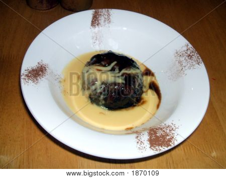 Dessert Of Sticky Toffee Pudding With Raisons & Custard