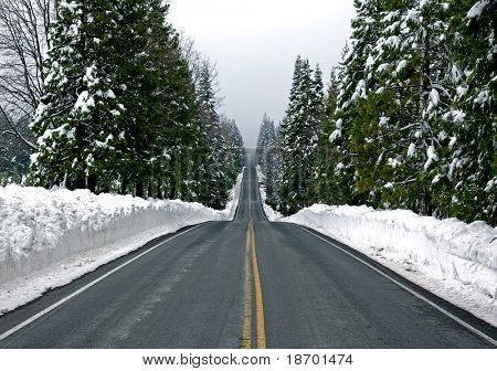 Road through snowy mountains