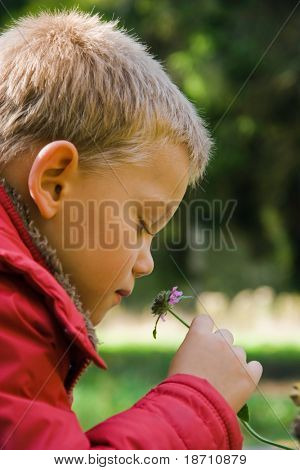 young child with flower in hand