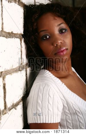 African American Girl Lean On Brick Wall