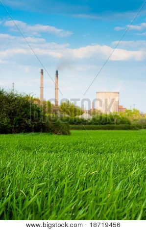 Fresh Green Grass With Nuclear Power Plant And Blue Sky
