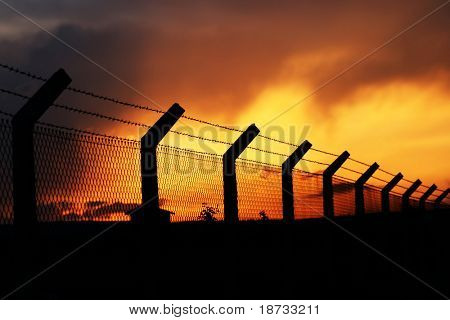 fence under sleeping sunset