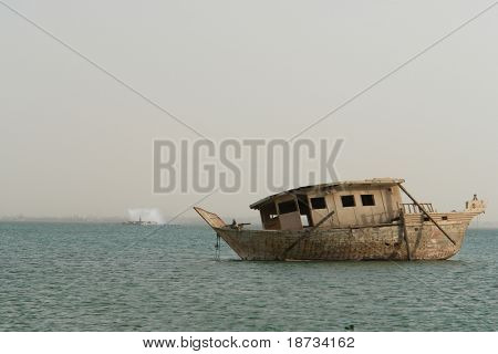An obsolete old fisher boat in Bahrain