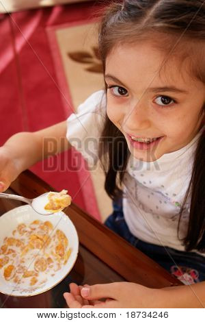 Girl eats corn flakes