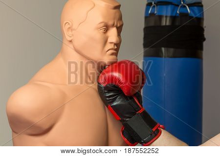 Red Boxing Gloves Punching An