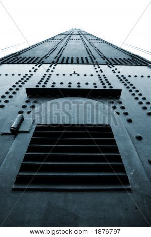 Huge Riveted Metal Tower With Grille