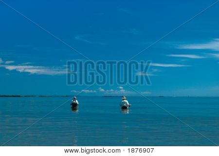 Two Flyfisherman Fishing The Flats For Striped Bass