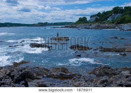 Stiper Fisherman Fishing Rocky Coast, Southern Maine
