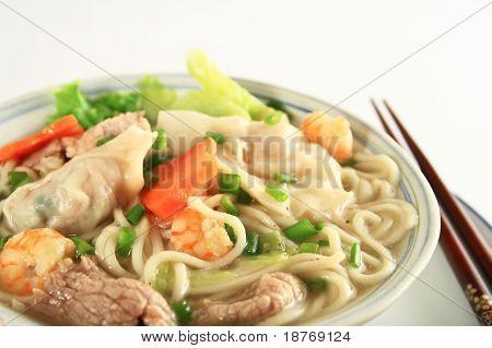 a bowl of hot wanton noodle soup