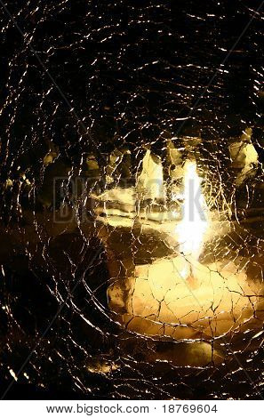 candle light reflection through shattered glass