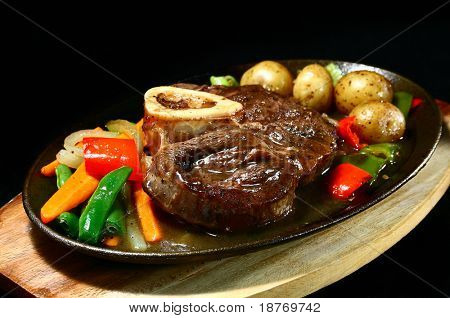 delicious beef shank served on a sizzling iron plate