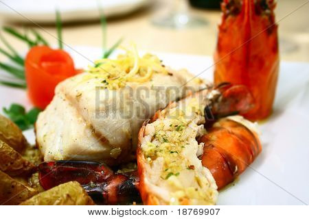 green grouper fillet with lemon zest and large prawns with garlic butter sauce