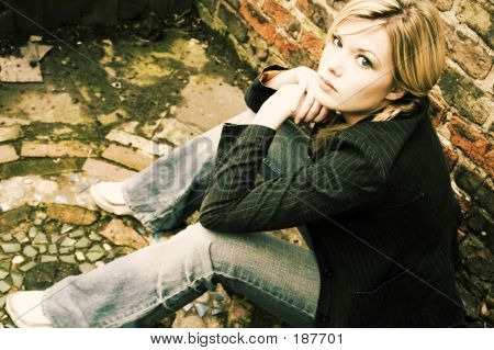 Blonde Girl Sitting