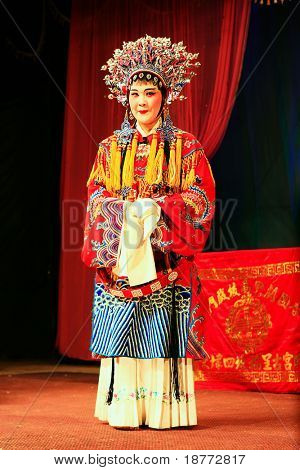 XIAMEN - APRIL 30: Actress of a traditional Chinese opera performs on stage in the province of China April 30, 2009 in Xiamen, China. Younger generations are not interested in this Chinese opera anymore.