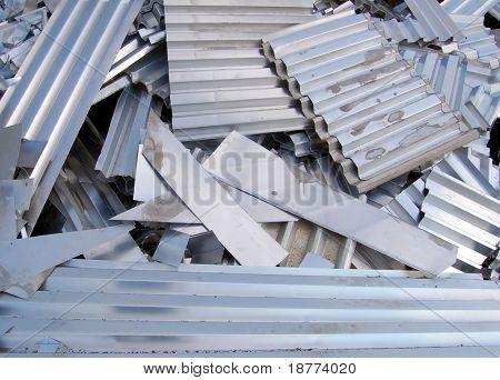 Aluminum scrap metal sheets on a recycling area