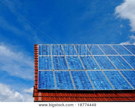 Solar energy panel on a red roof