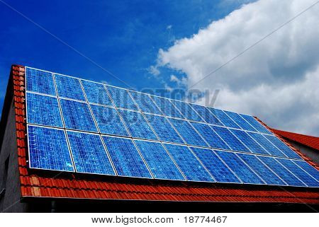 Blue solar panel on the roof of a house