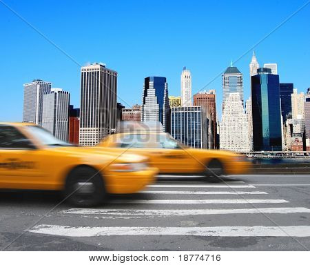 Yellow cabs in front of the Manhattan skyline in New York