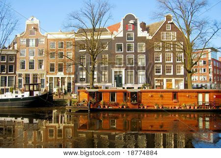 Street on a canal with beautiful houses in Amsterdam