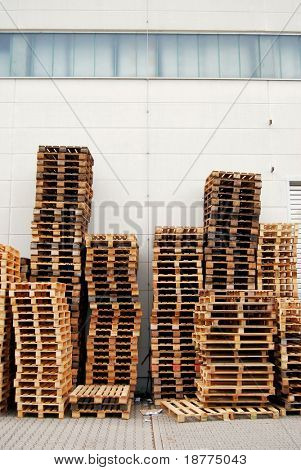 Wooden pallets in front of a warehouse
