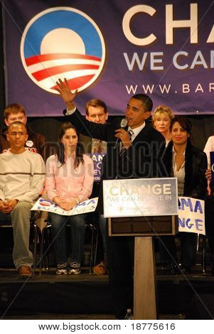 Senator Barack Obama campaigning for president, lifting hand