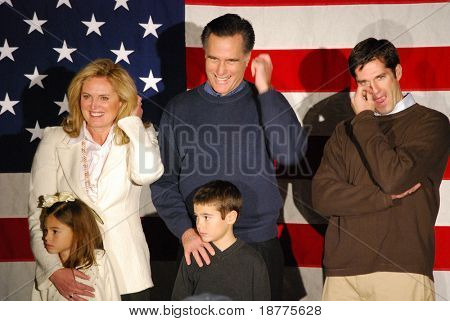 Governor Mitt Romney campaigning with family, all fingering something