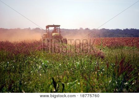 Tractor ploughing fallow field