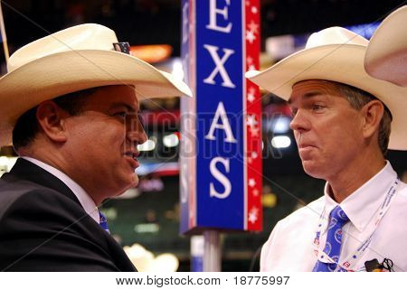 ST PAUL - SEPT 3: Texas delegates Rene Diaz (L) and David Barton (R) chat while at the Republican National Convention at the Xcel Energy Center on September 3, 2008 in St Paul, Minnesota.
