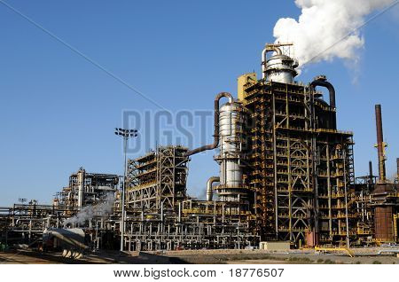Smoke rising above a petrochemical plant