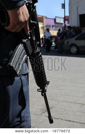 Closeup of M4 carbine / assault rifle held by a special forces soldier on the Mexican side of the US-Mexico border