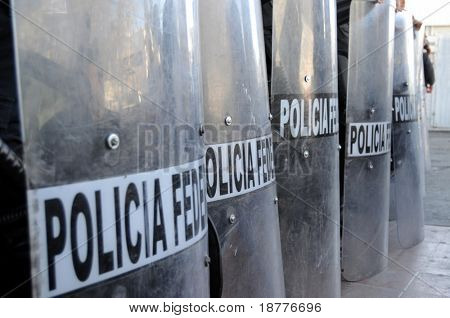 Shields of Mexican federal police forces maintaining order in the violent border city of Ciudad Juarez