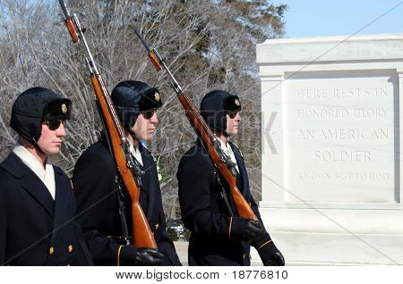 ARLINGTON - March 3: Changing of the guards on a winter day on March 3 2009 at the Tomb of the Unknown Soldier at the Arlington National Cemetery in Virginia.