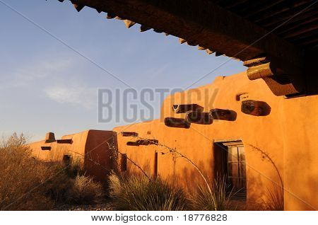 Traditional adobe architecture in New Mexico at sunset
