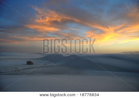 White gypsum dunes after sunset at the White Sands National Monument in New Mexico, one car visible for scale