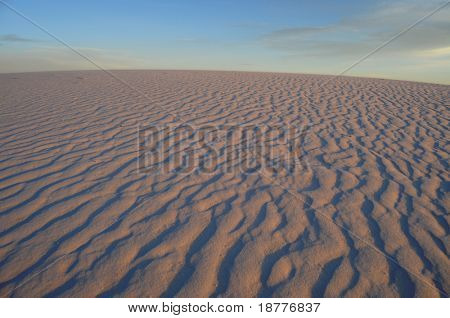 White gypsum dunes just before sunset in the desert at the White Sands National Monument in New Mexico