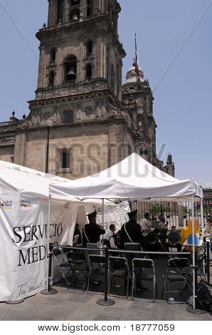 MEXICO CITY - APRIL 29: Police officers stand guard at a makeshift clinic on April 29, 2009 in Mexico City. Doctors are trying to detect patients with the Swine Flu.