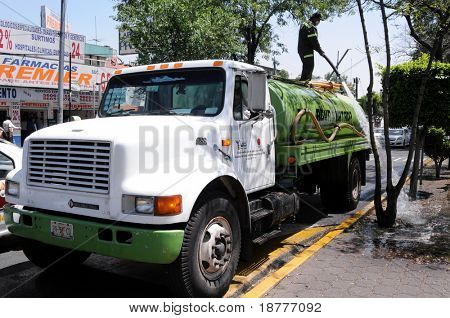MEXICO CITY - APRIL 28: A water truck washes and cleans the street of Calzada de Tlalpan in front of a hospital in Mexico City, during the outbreak of the flu epidemic on April 28, 2009 in Mexico CIty.