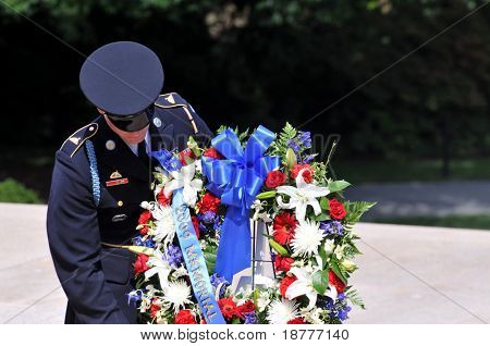 ARLINGTON - MAY 23: Guard lays a wreath at the Arlington National Cemetery in preparation for Memorial day ceremonies on May 23, 2009 in Arlington.
