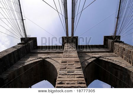 The Brooklyn Bridge, built in 1883, is one of the oldest suspension bridges in the United States. View from the pedestrian walkway straight up towards the tower.