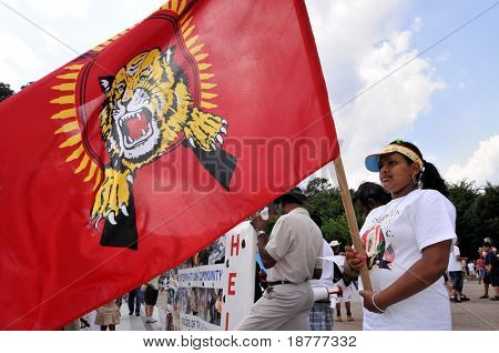 WASHINGTON - JULY 4: A woman holds the Tamil Tigers flag in a rally in front of the White House in Washington on July 4, 2009. The rally blamed Sri Lanka for human rights violations against Tamils.
